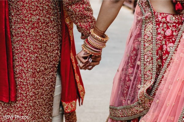 Sweet Indian couple holding hands.