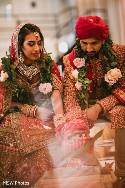 Wonderful Indian couple with hands tied at ceremony.