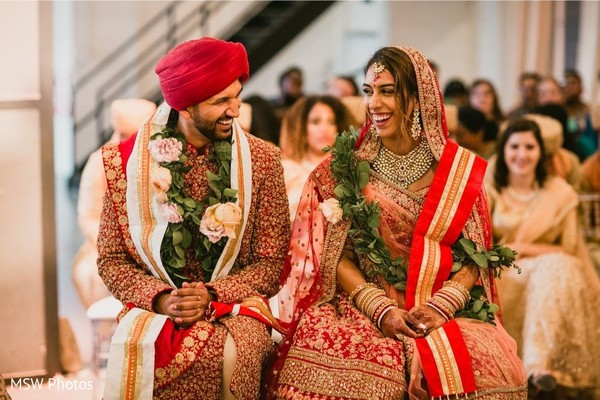 Adorable indian bride and groom capture at ceremony.
