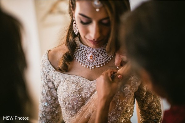 Adorable indian bride getting ready.