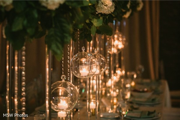 Majestic indian wedding reception table decor.