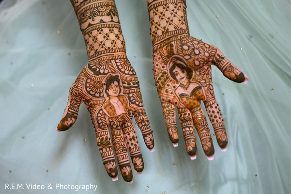 Detailed Indian bridal henna art capture.