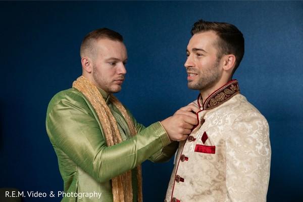 Indian groom getting his sherwani on.