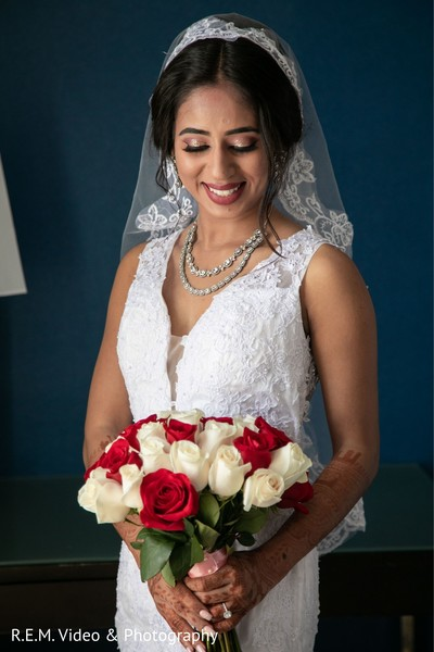 Lovely Indian bride holding her wedding bouquet.