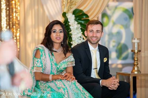 Sweet indian couple at reception capture.