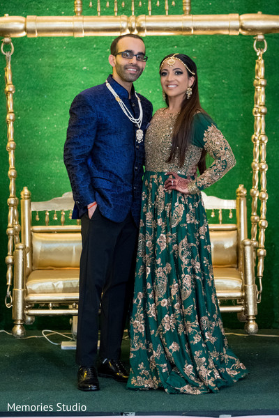 Ravishing indian bride and groom sangeet outfit