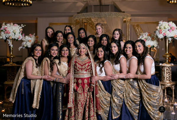 Indian bride and bridesmaids posing with their ceremony outfit