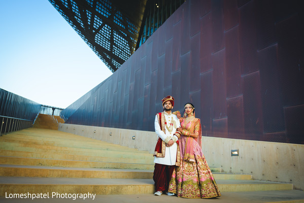 Gorgeous couple posing for pictures.
