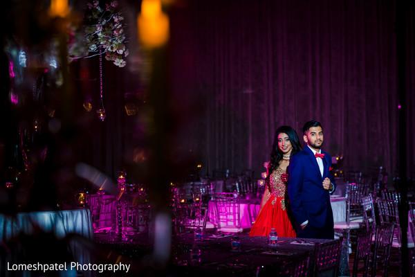 Indian bride and groom posing.