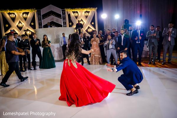 Indian groom and bride dancing.