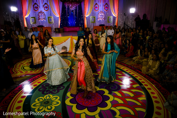 Stunning Maharani with guests dancing.