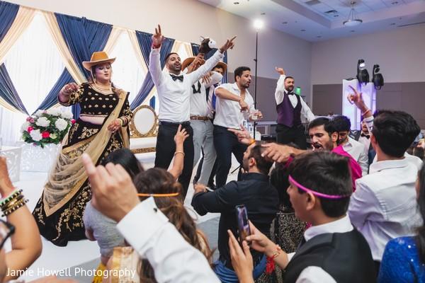 Joyful wedding reception, bride and groom dancing photography