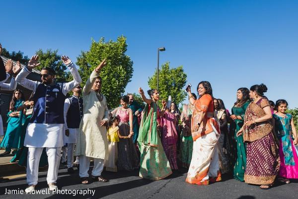 Joyful indian wedding baraat procession