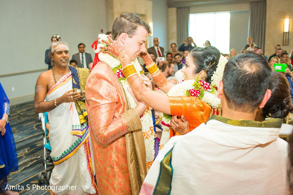 Maharani putting garland on her groom.