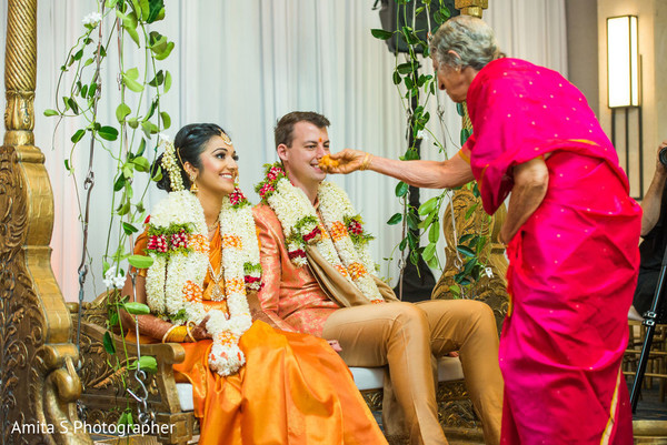 Merry Indian couple in their wedding ceremony.