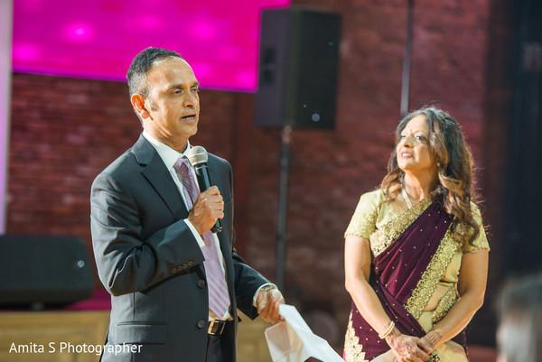 Indian relatives giving a speech.