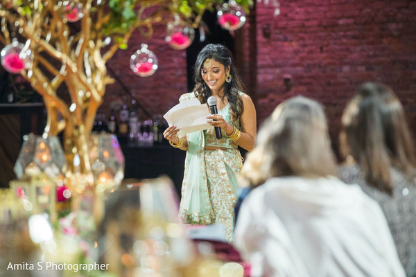 Bridesmaid reading for the Indian couple.