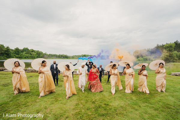 Indian bridesmaids with couple outdoors.