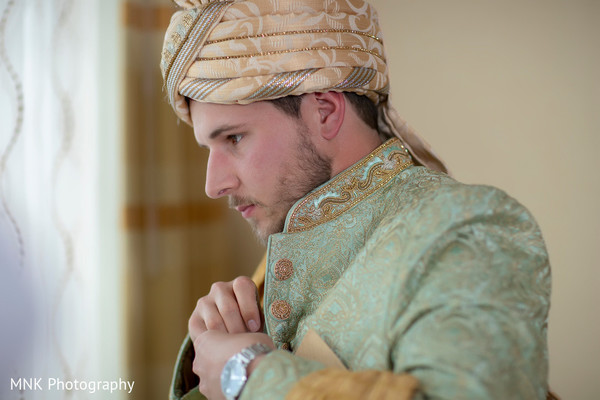 Adorable indian groom getting ready