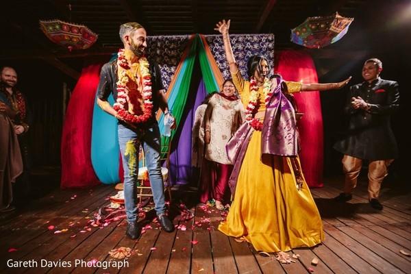 Joyful India couple at their haldi party.