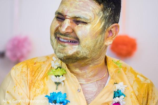 Indian groom havinf fun in Pithi ritual.