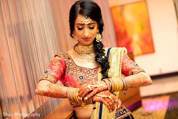 Enchanting Indian Bride fixing her bangles.