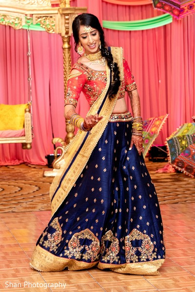 Maharani Indian bride dancing at her sangeet party.