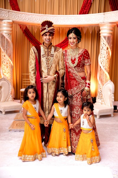 Enchanting indian couple with family relatives.