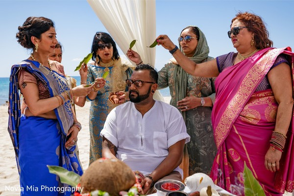 Indian relatives with groom at his haldi ritual.