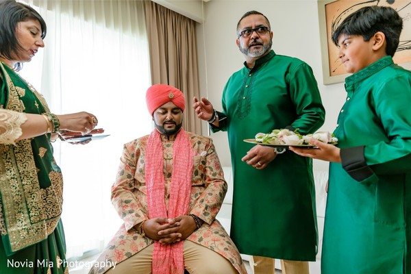 Indian groom getting blessed by relatives.