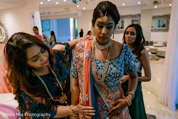 Indian bride with relatives getting ready for her big day.
