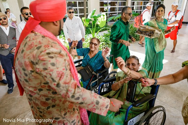 Indian groom celebrating with relatives.