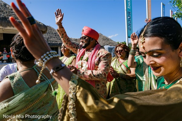 Upbeat Indian grooms baraat procession.