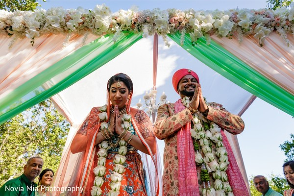 Traditional Indian bride and groom's jaimala ceremony.