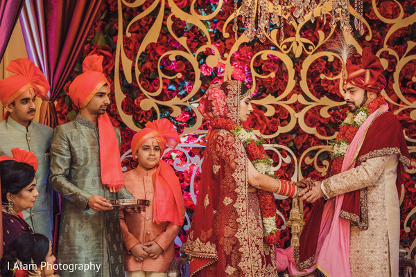 See this gorgeous couple holding hands during the ceremony.