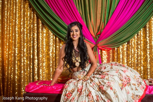 Indian bride posing for pictures.