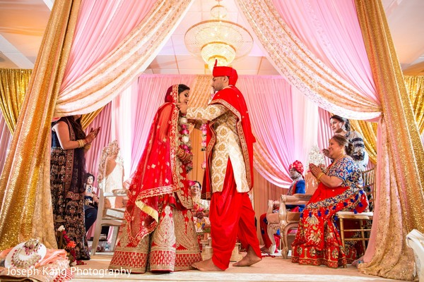 Indian groom and bride during the garland exchange.