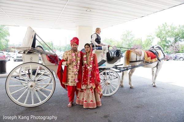 Raja and Maharani beaming.