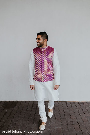 Indian groom posing for pictures.