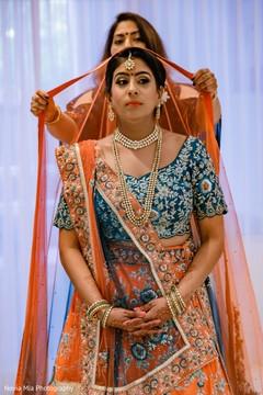 Enchanting Indian bride getting her ghoonghat on.