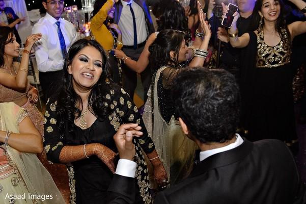 Upbeat indian bride and groom dancing