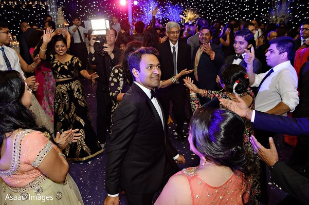 Indian groom celebrating during reception party