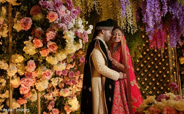 Dreamy indian bride and groom surrounded by flowers photography.