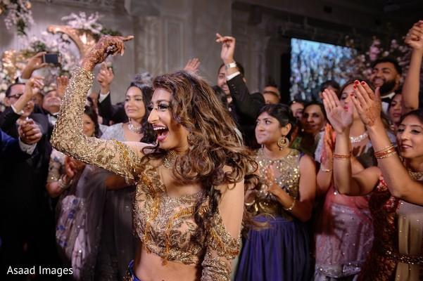 Joyful indian bride dancing