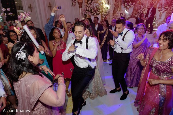 Indian groom having a great time at his reception party