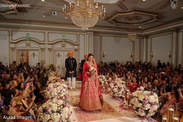 Ravishing indian bride making her entrance to wedding ceremony