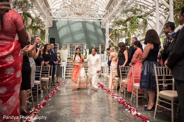 Maharani being escorted through the wedding aisle.