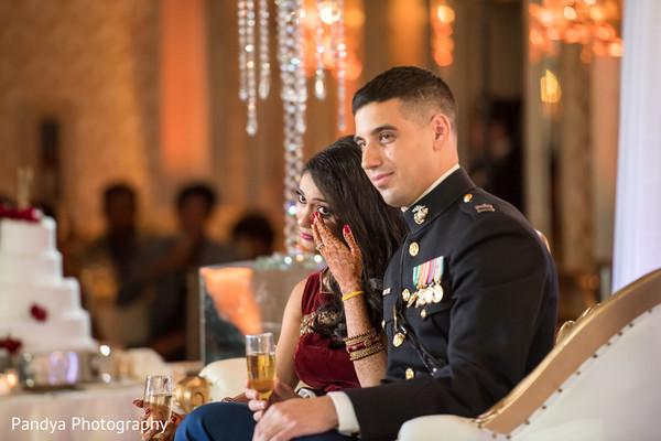 Elegant indian couple sitting together.