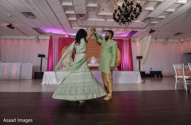 Indian couple dancing during their Sangeet.