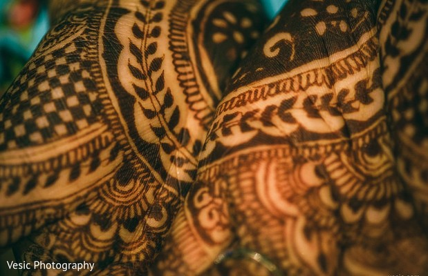 Intrincated Indian bridal mehndi art.